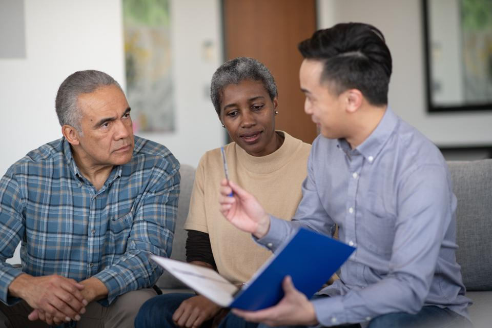 An Elderly African American Couple Meet With Their Adviser stock photo