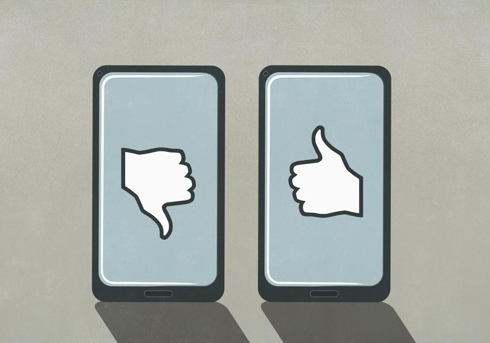 Thumbs up and thumbs down symbols on smart phone screens
